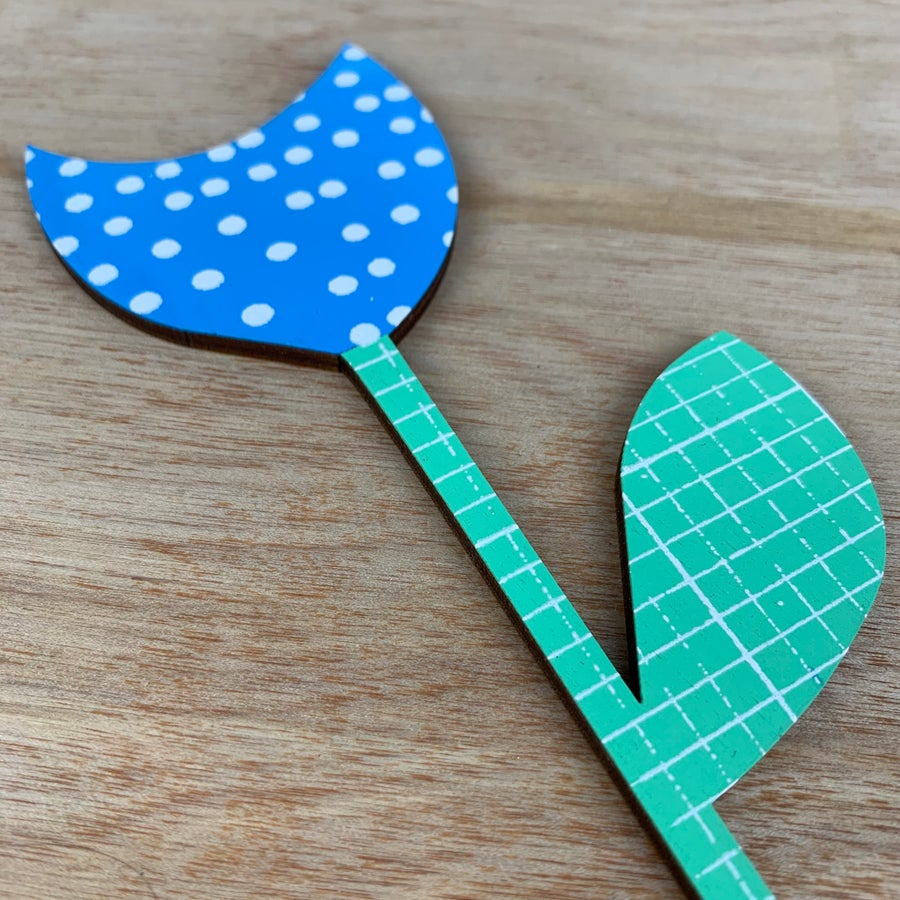 Image of Blue and white dot with mint green hand screen printed wooden flower