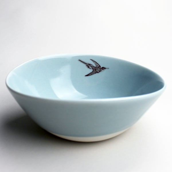 Image of organic serving bowl with hummingbird, ocean