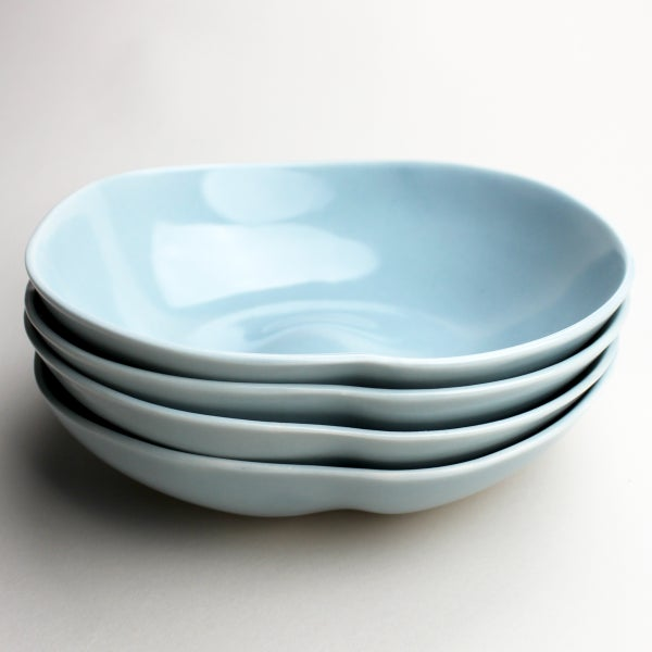 Image of set of four organic bowls, ocean