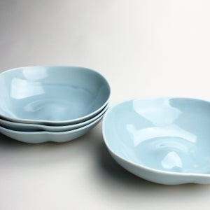 Image of set of four organic bowls, ocean