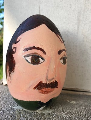 Image of Edgar Allan Poe. Painted wooden egg.