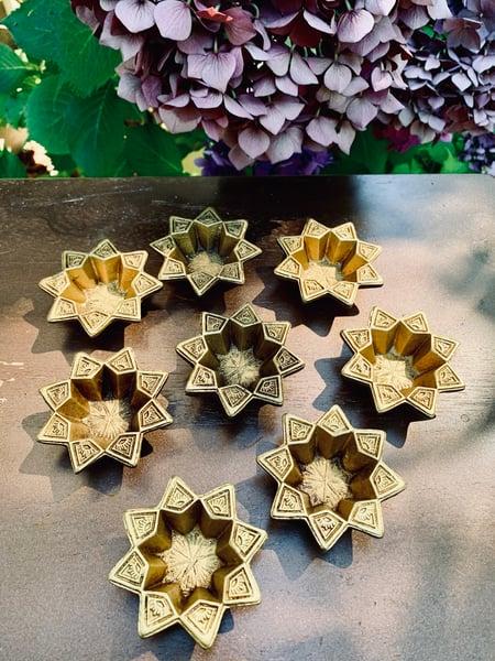 Image of Pair of Star shaped brass diya