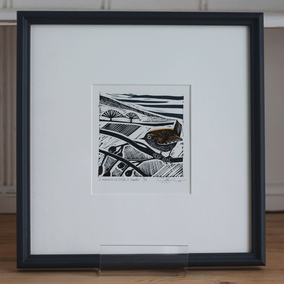 Image of 'A moment to catch a breath' framed linocut
