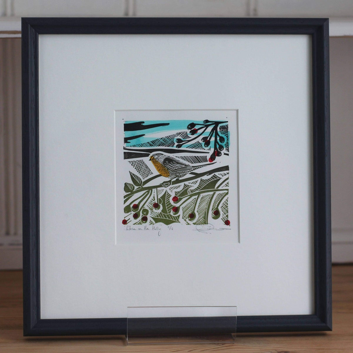 Image of 'Into the holly and the hedgerow' framed linocut