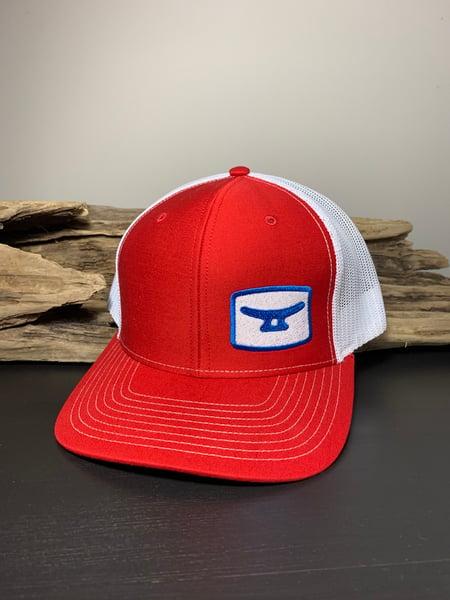 Image of Red white/ blue/white logo blue MTD on back edge