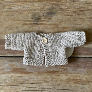 Image of Knitted cardigan to suit 32cm Miniland doll - 'Oatmeal'