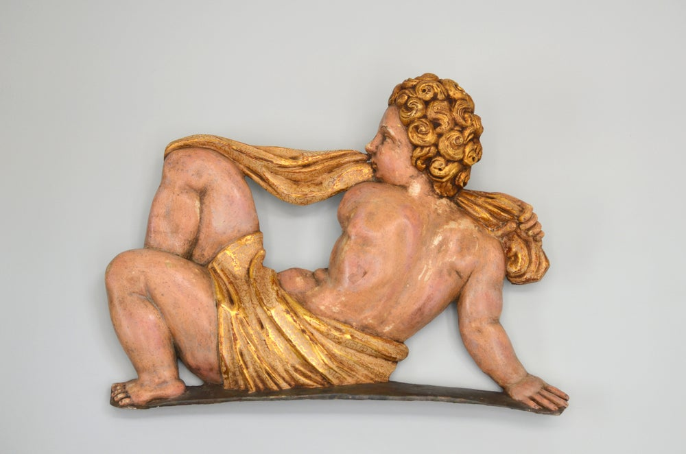 Image of Elegant and finely preserved late Renaissance Spanish polychrome and gilded wood relief of a Putto