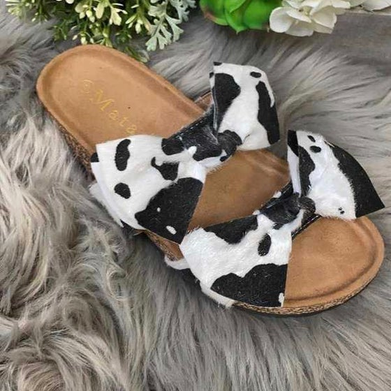 Image of Cow print bow flip flop