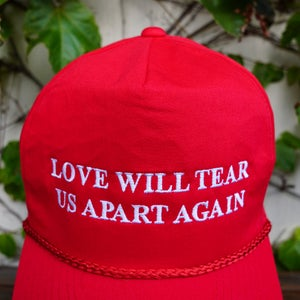Love will tear us apart again hat