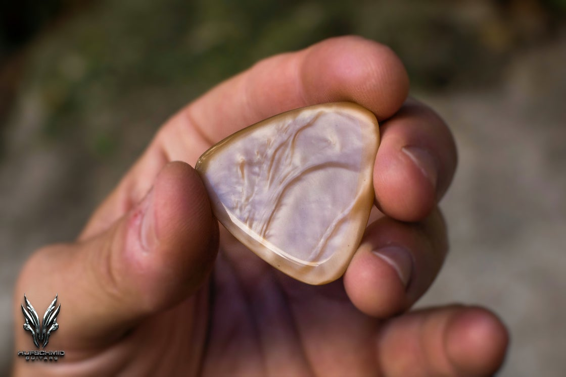 Image of NEW: The ~4mm GALALITH 'Liquid Gold' plectrum