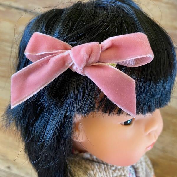 Image of Velvet bow clip to suit 38cm Miniland doll