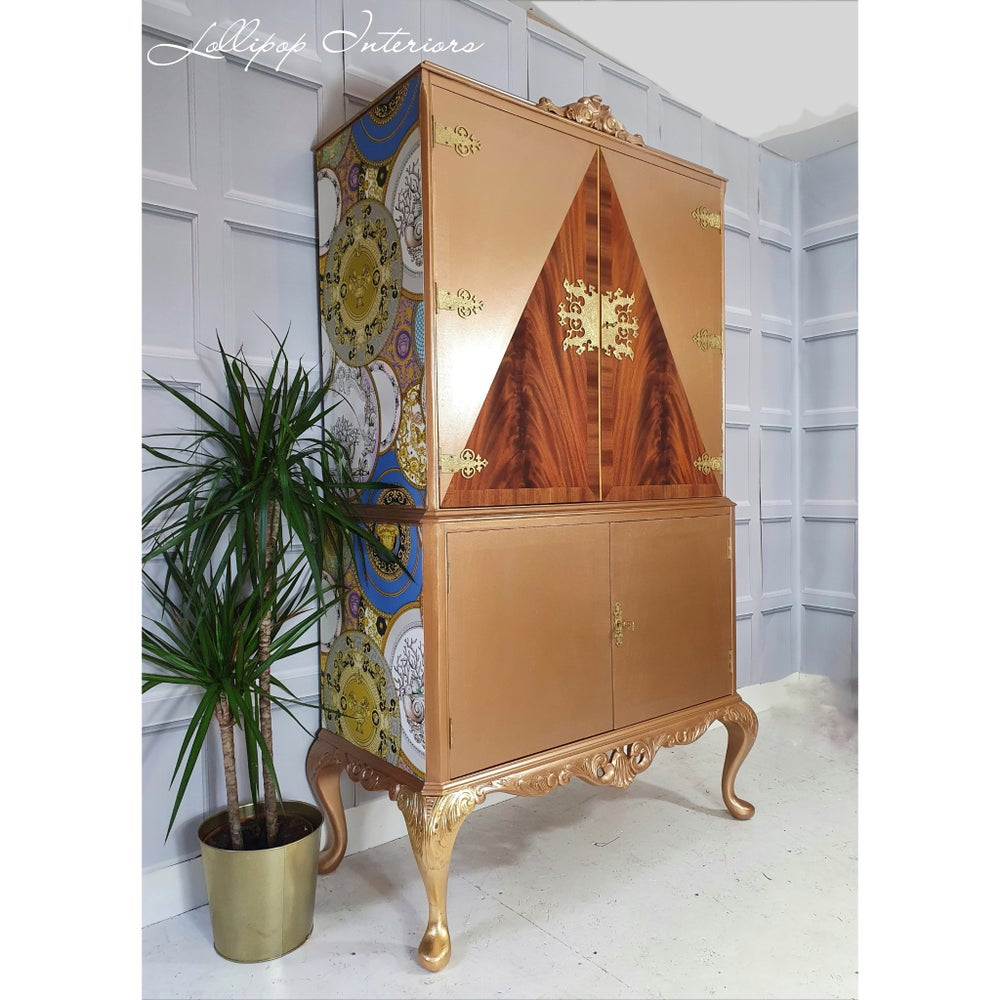 Image of Gold cocktail cabinet with versace wallpaper