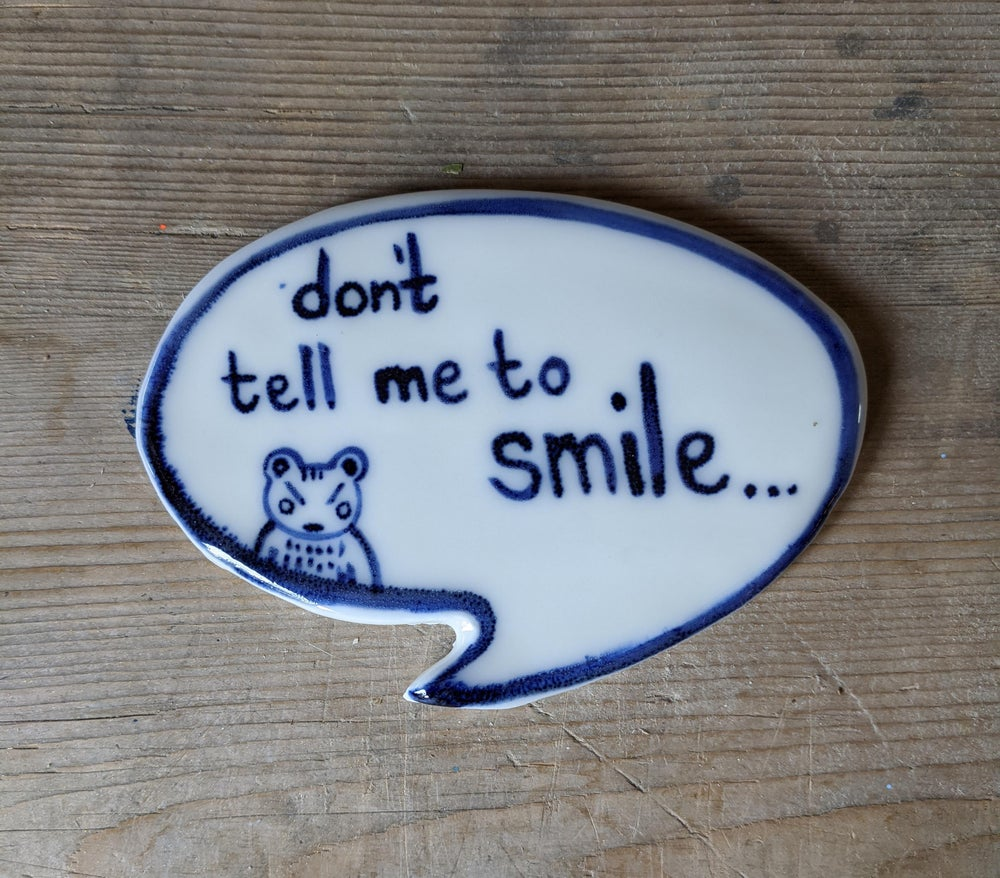 Image of don't tell me to smile - porcelain plaque