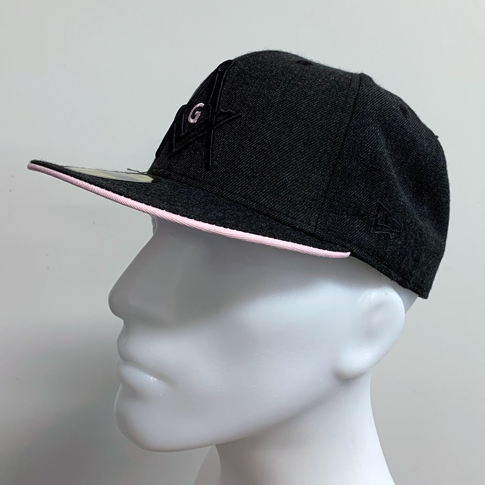 Image of Heather Black with pink New Era 59Fifty fitted.