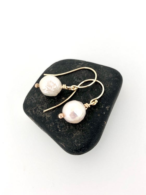 Image of white baroque pearl earrings in 14k gold