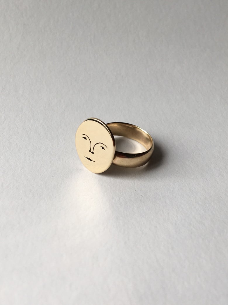 Image of sun face ring 9 carat gold