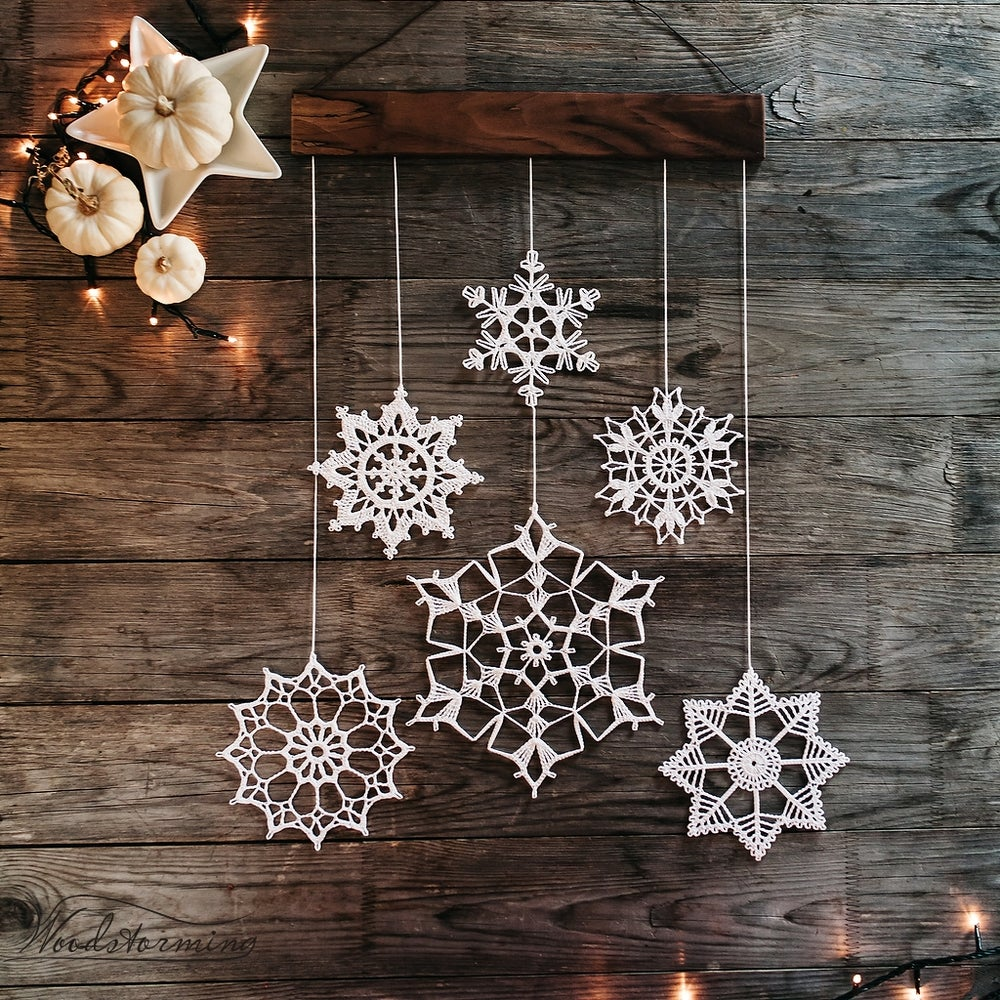 Image of Elegant Christmas decoration - snowflakes and wood mobile