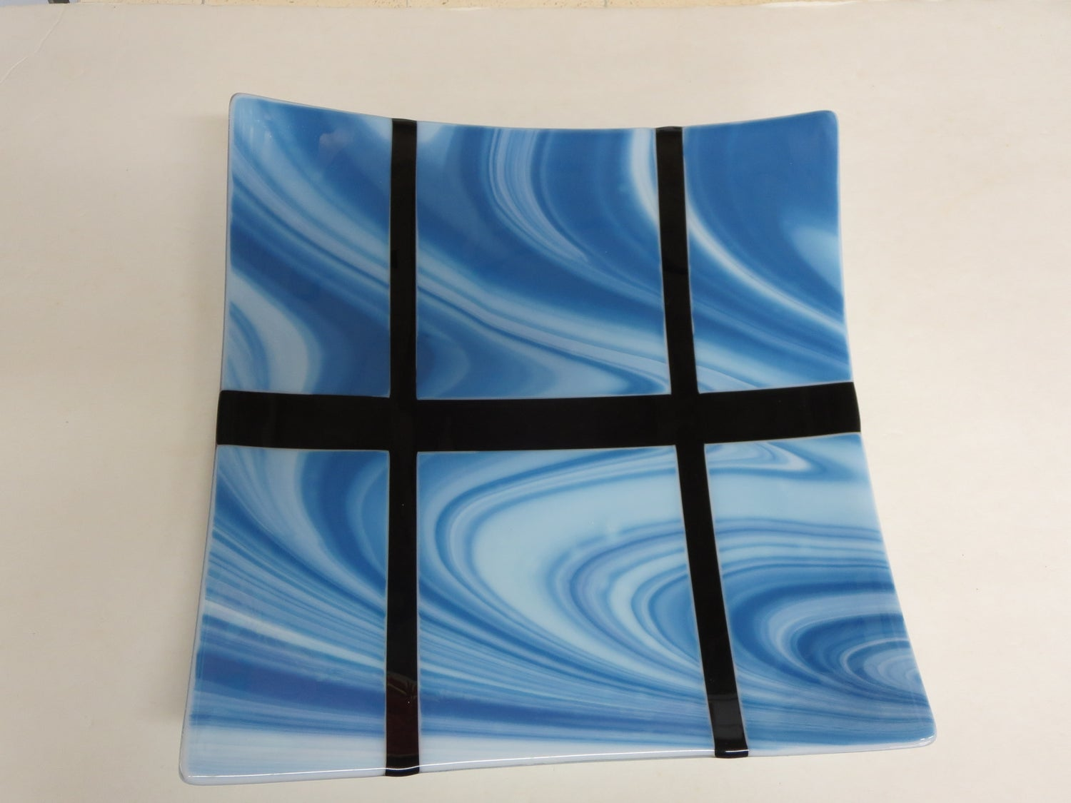 A Blue Plate with Black Accents - FG-077