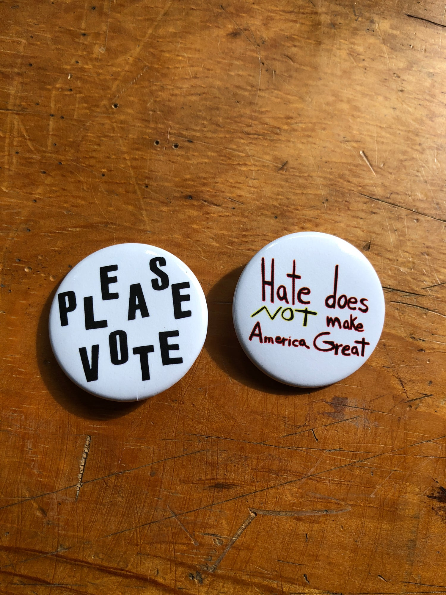 Image of Please Vote Because Hate Doesn't Make America Great Buttons