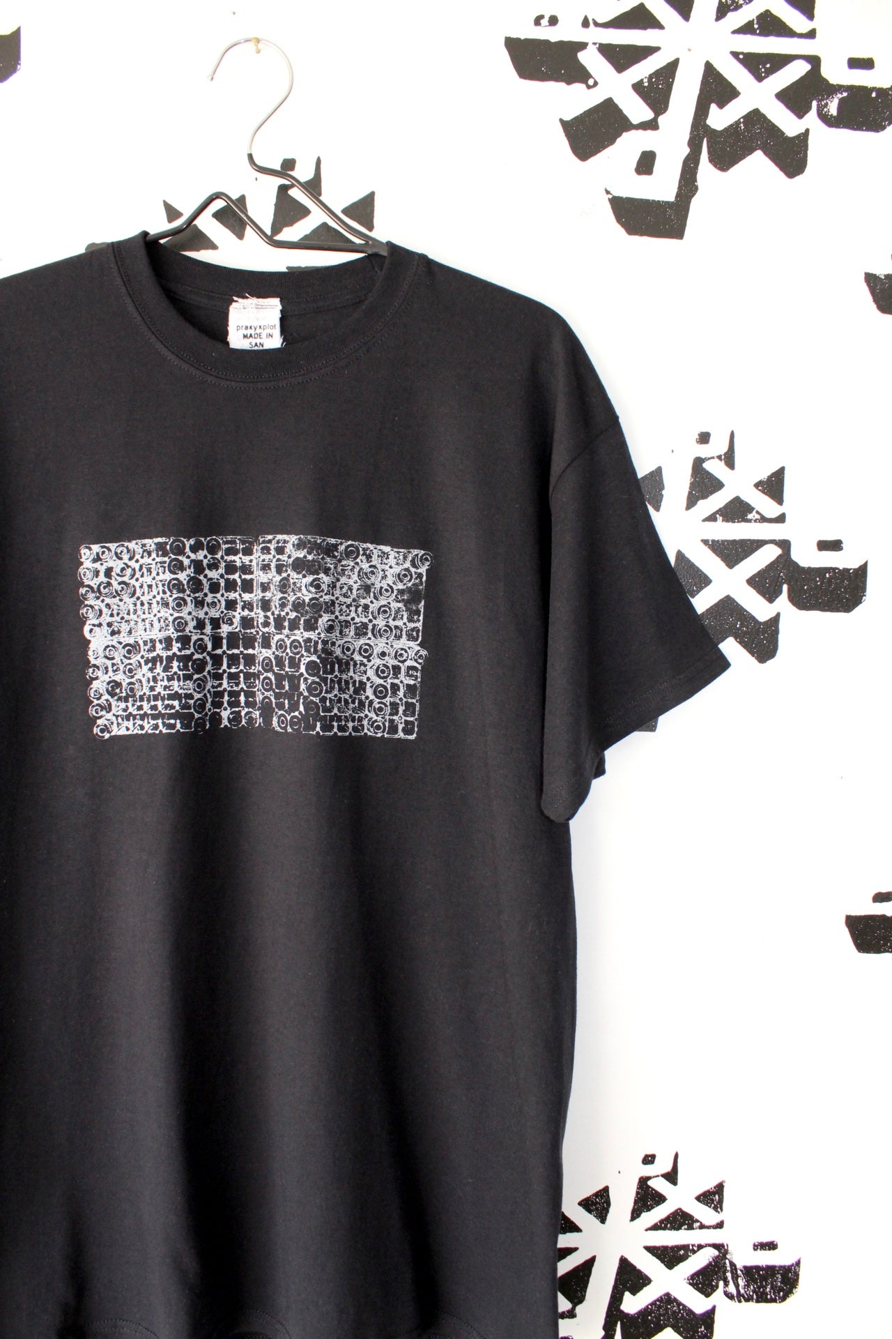 Image of locked and loaded tee in black