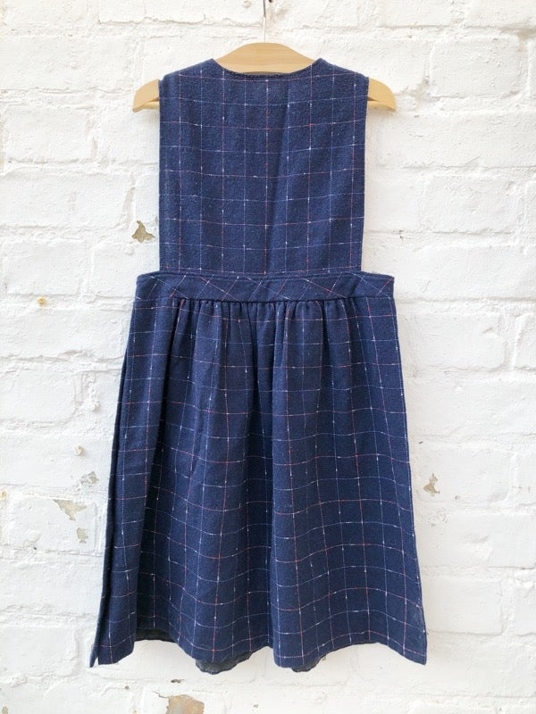 Image of Navy, fine wool, 50's pinafore dress with multicoloured checks. Age 5-6yrs