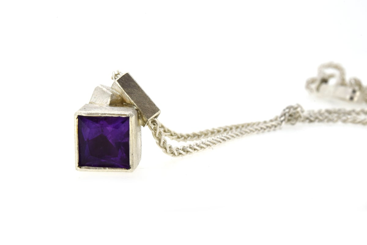 Amethyst pendant of geometric form, intersecting to form one complex shape