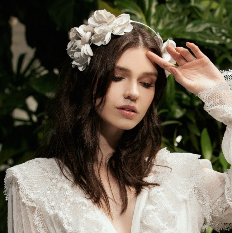 Image of White floral head band.