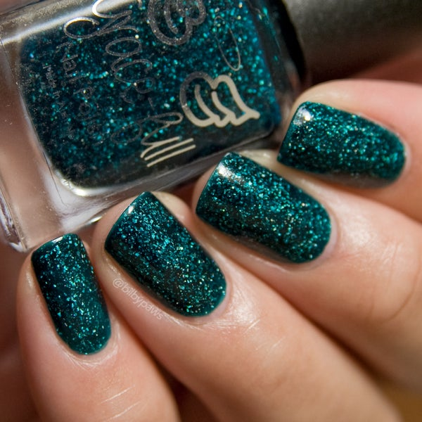 Image of Evergreen Envy – a jelly teal coloured base with a smattering of holo flakes