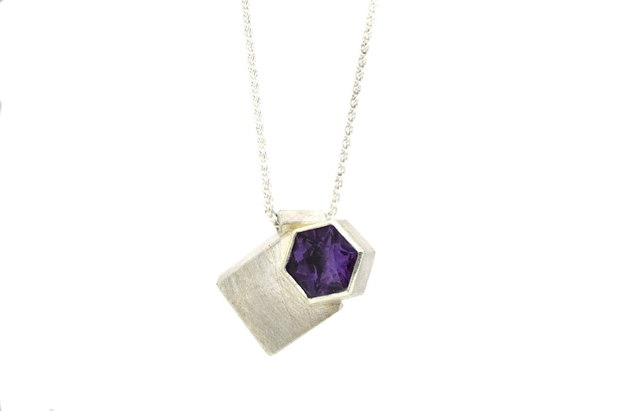 Sterling silver geometric pendant. Intersecting cube and and hexagonal prism set with amethyst
