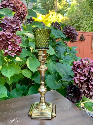 Image of Tall mid century brass candlestand paired with vintage diamond cut votive.
