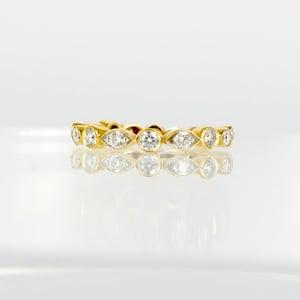 Image of 18ct yellow gold celebration style diamond ring