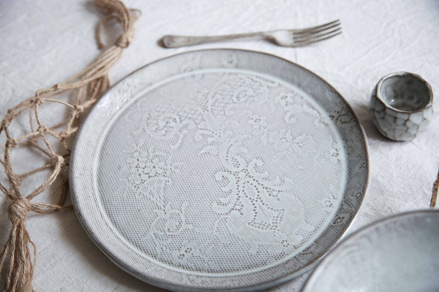 Image of Dinner plate, lace patterned.