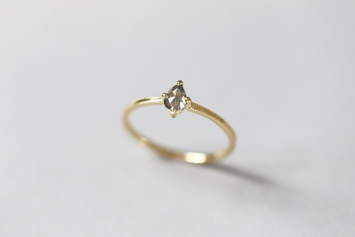 Image of 18ct gold, pear shape 'salt and pepper' diamond ring IOW157