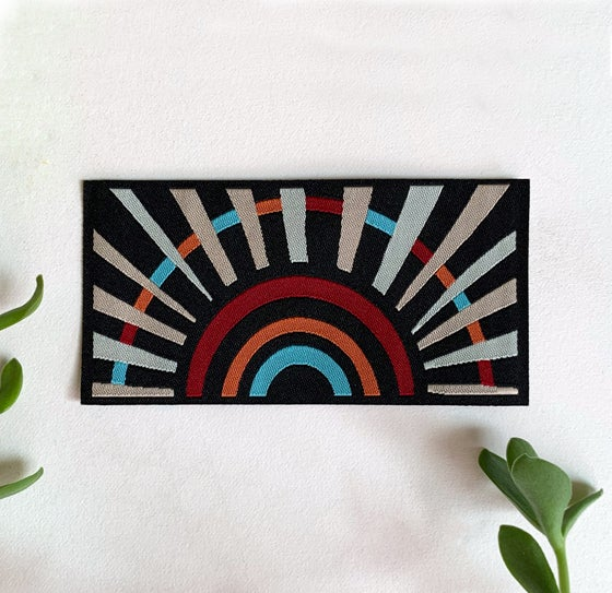 Image of Black Sunbow - Woven Iron-on Patch