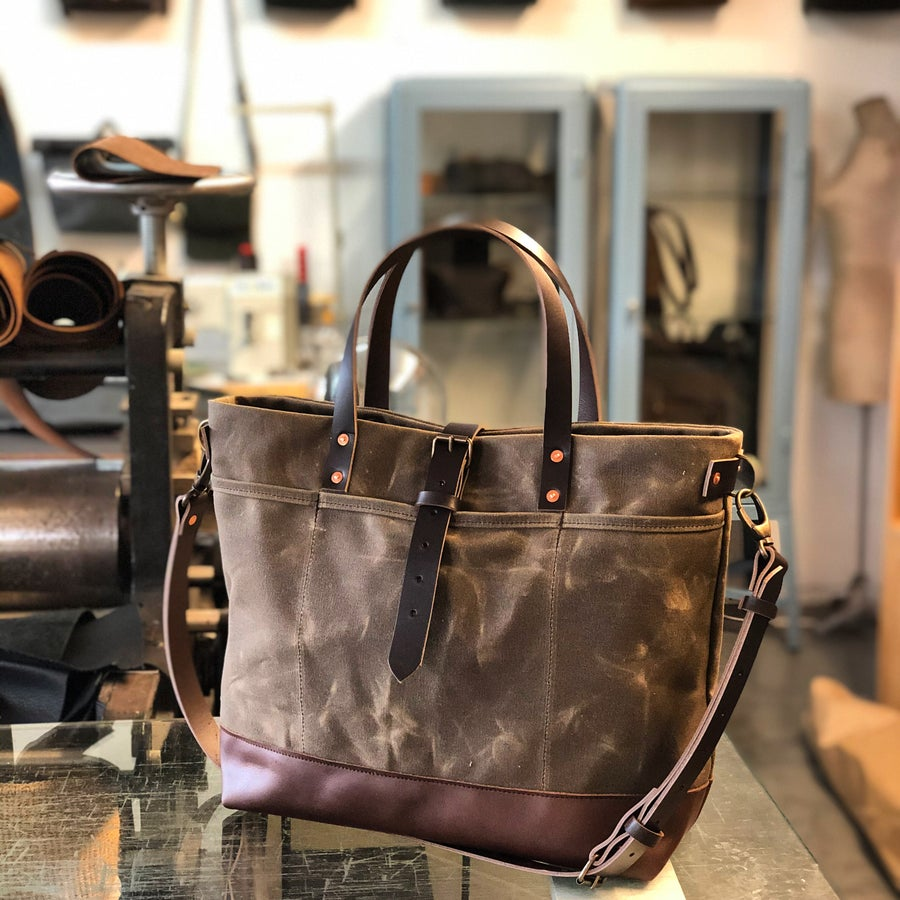Image of Field tan tote bag in waxed canvas with leather bottom and cross body strap