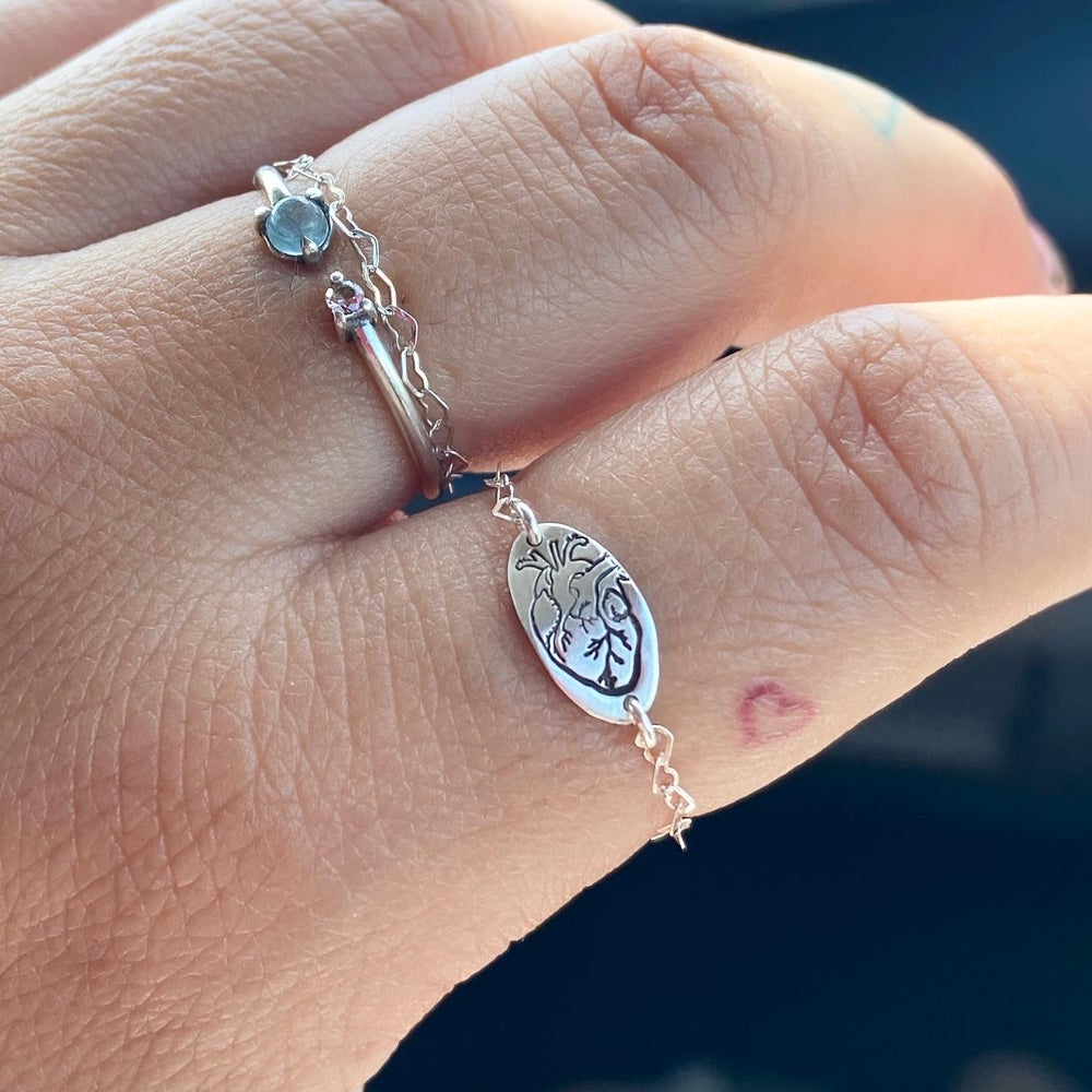 Image of Anatomical heart and chain ring