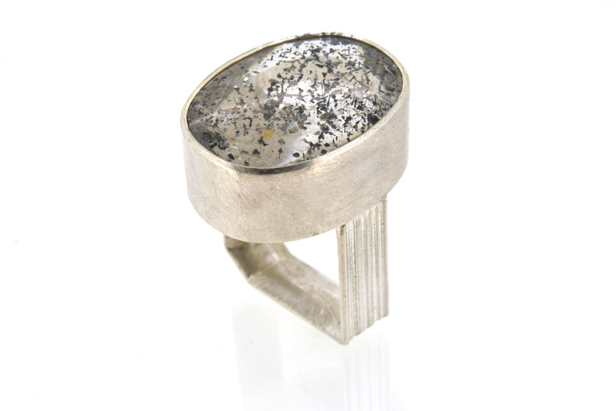 Monolith ring in sterling silver with oval Quartz with dark pyrite inclusions