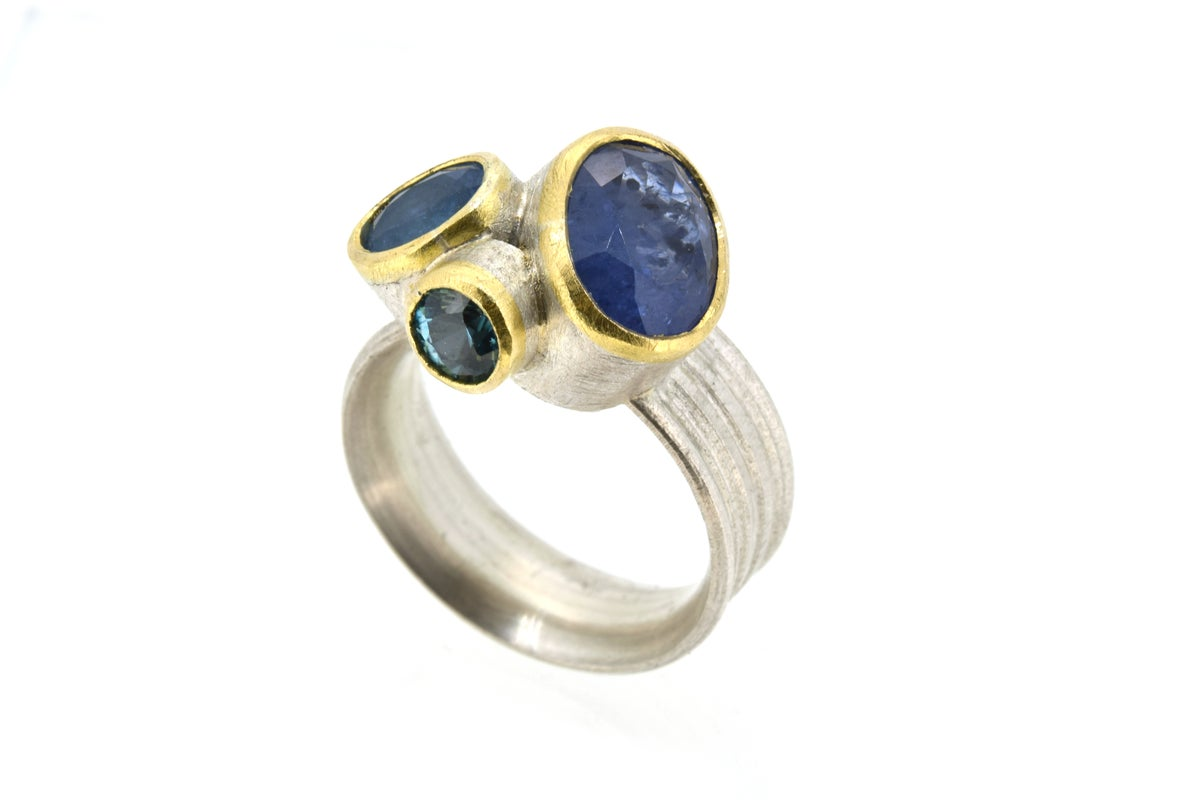 Cluster ring of sapphire, aquamarine and zircon