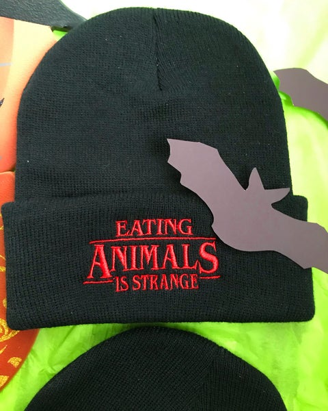 Image of Eating animals is strange beanie