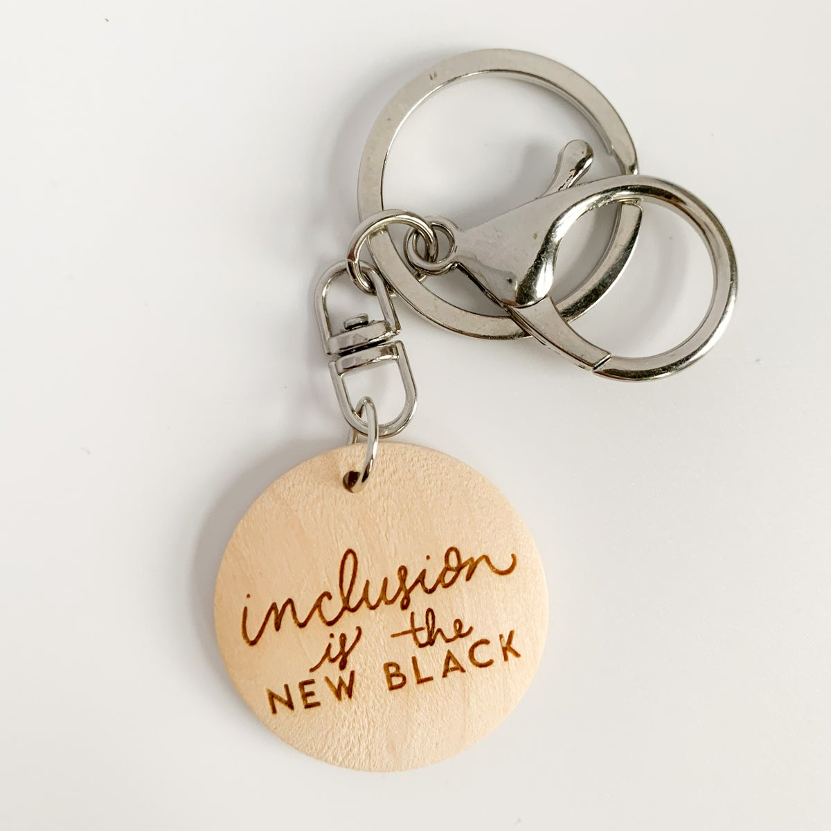 Image of Inclusion is the new black laser engraved keychain