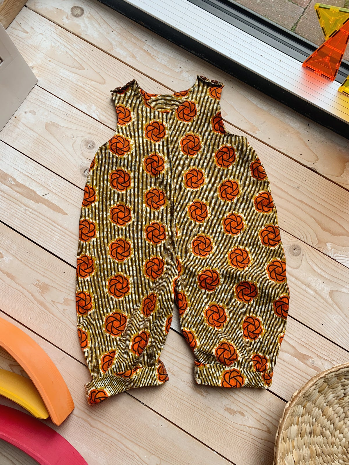 Image of THE TRAVERS ROMPER