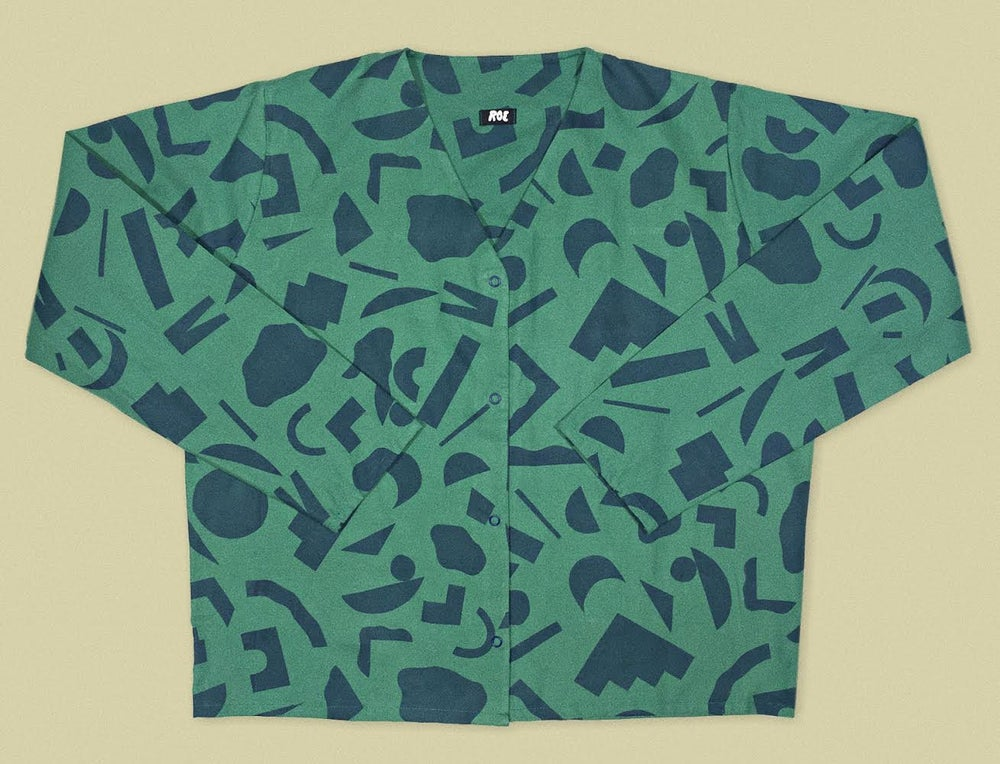 Image of BLUE CUT OUTS GREEN SHIRT