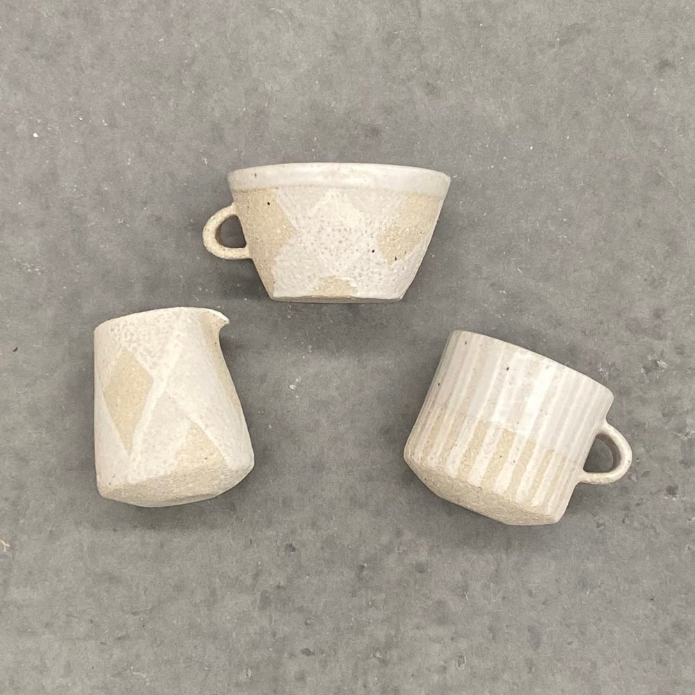Image of Raw white teacups and pourer