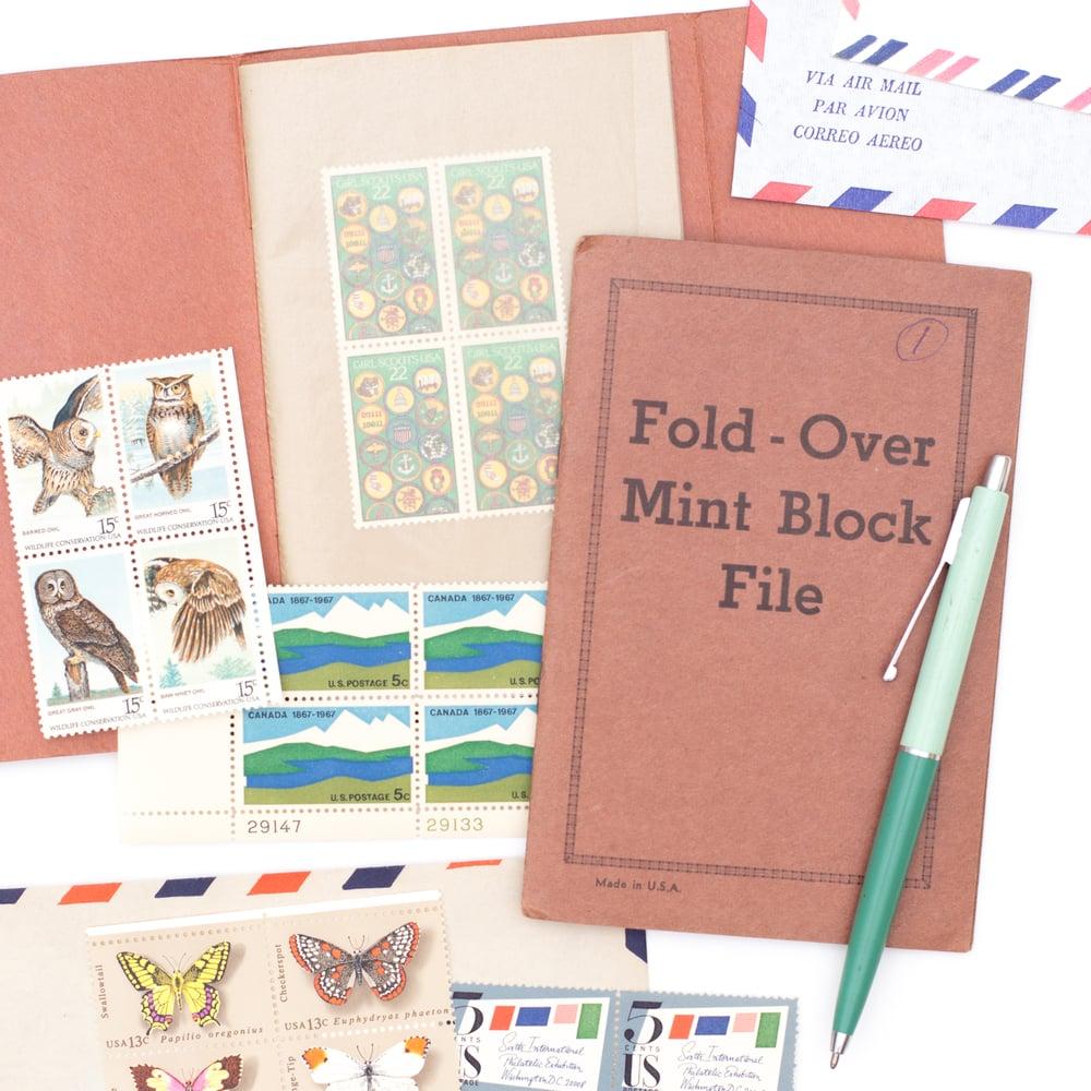 Image of Vintage Pocket Stamp File Booklet with Stamps