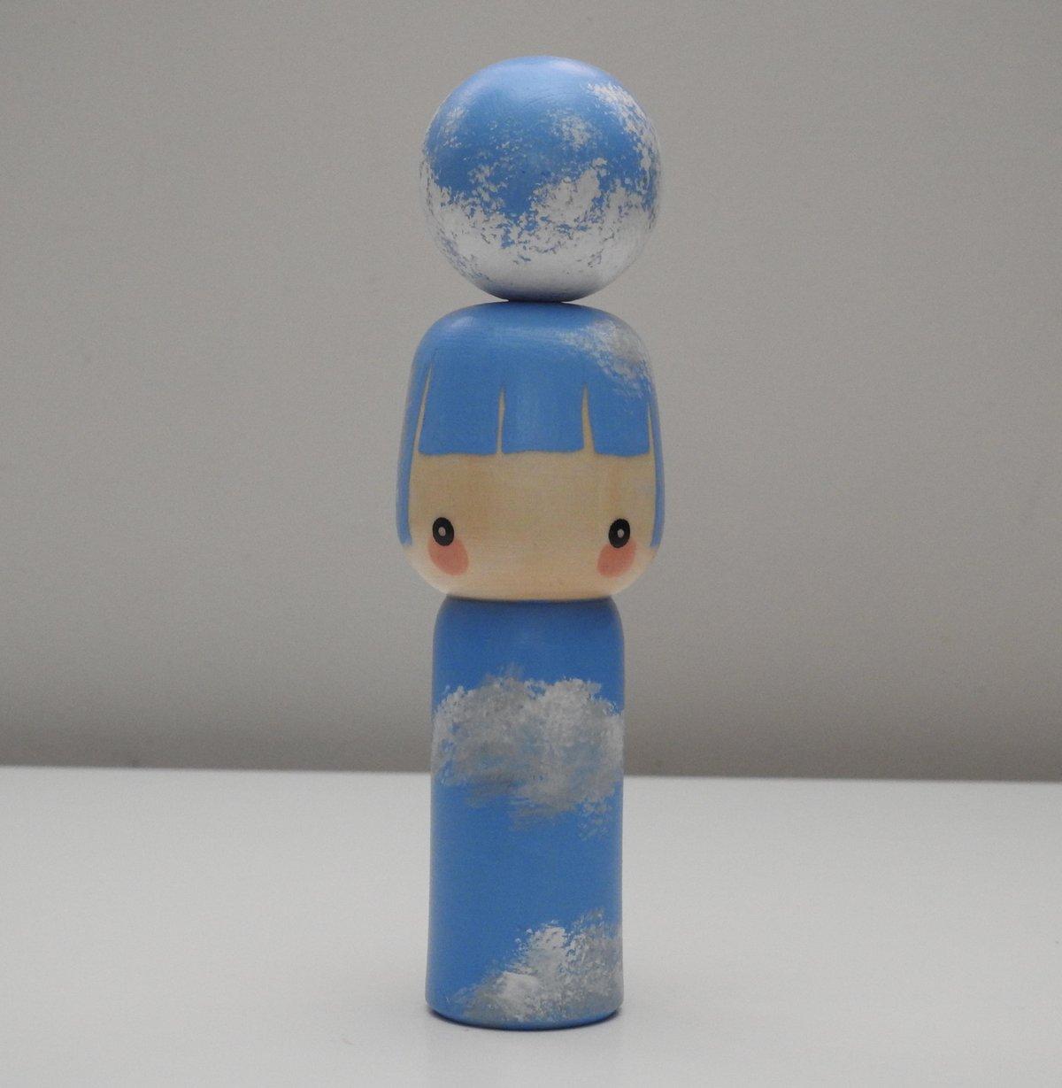 Image of moon girl (daytime moon)