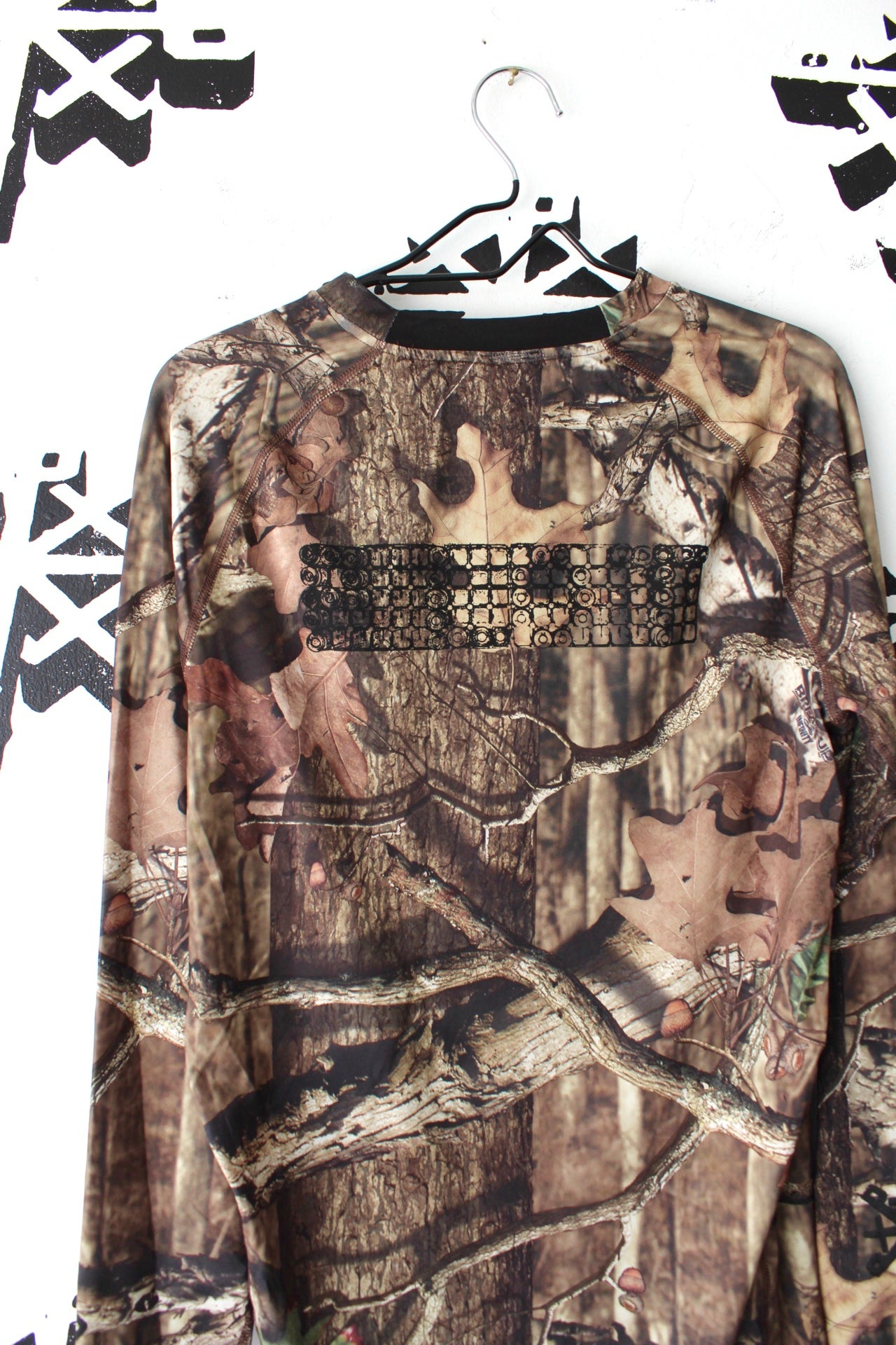 Image of locked and loaded long sleeve in forest camo