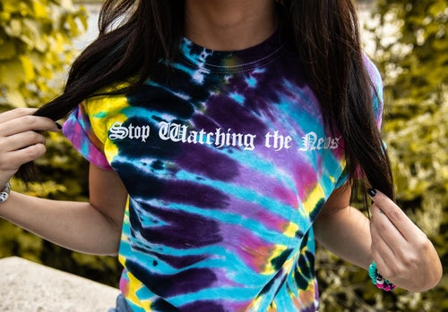Image of Stop Watching the News tie-dye tees