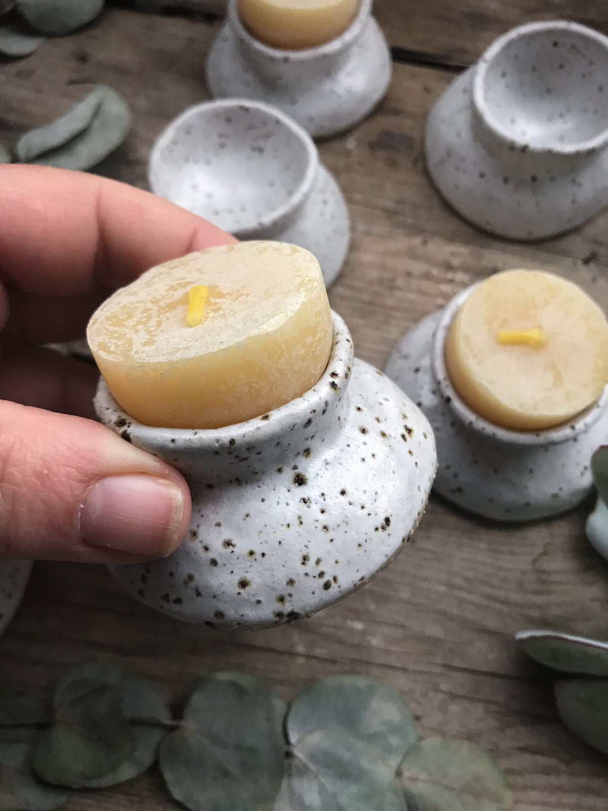Image of White speckle candle holders/ egg cups
