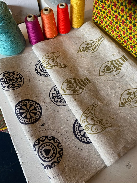 Image of Hand printed Festive panel, on linen, with 12 motifs..ready for embroidery