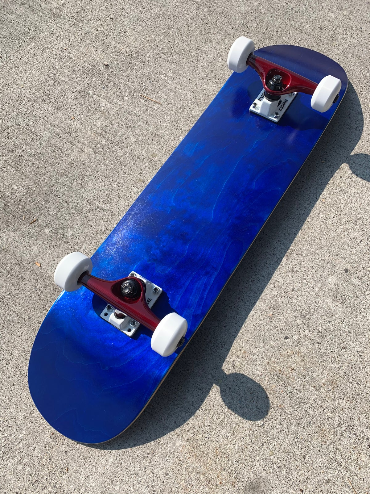 """Image of Blue Stained 7.75"""" Complete Skateboard w/ Core trucks"""